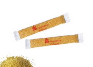 Zlatý cukr v reklamním obalu