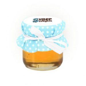 Med s plátěným víčkem